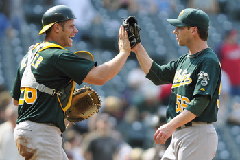 Anthony Recker (left) played in 5 games with the Oakland A's in 2011.