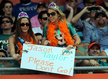 MIAMI GARDENS, FL - JANUARY 01: Fans of  Defensive end Jason Taylor #99 of the Miami Dolphins hold a sign against the New York Jets at Sun Life Stadium on January 1, 2012 in Miami Gardens, Florida.  (Photo by Marc Serota/Getty Images)