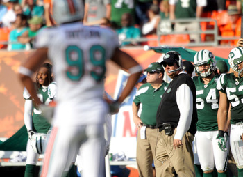 MIAMI GARDENS, FL - JANUARY 01:  Defensive end Jason Taylor #99 (L) of the Miami Dolphins stares at coach Rex Ryan of the New York Jets at Sun Life Stadium on January 1, 2012 in Miami Gardens, Florida.  (Photo by Marc Serota/Getty Images)