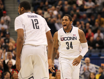 HARTFORD, CT - JANUARY 9:  Andre Drummond #12 of the Connecticut Huskies celebrates with teammate Alex Oriakhi #34 during a game against the West Virginia Mountaineers in the second half at the XL Center on January 9, 2012 in Hartford, Connecticut.  (Phot