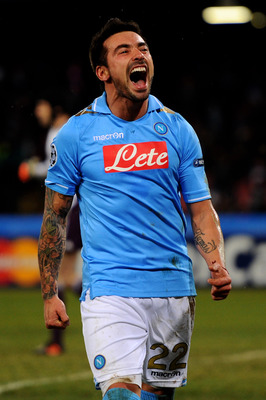 NAPLES, ITALY - FEBRUARY 21:  Ezequiel Lavezzi of Napoli celebrates after scoring his team's third goal during the UEFA Champions League round of 16 first leg match between SSC Napoli and Chelsea FC at Stadio San Paolo on February 21, 2012 in Naples, Ital