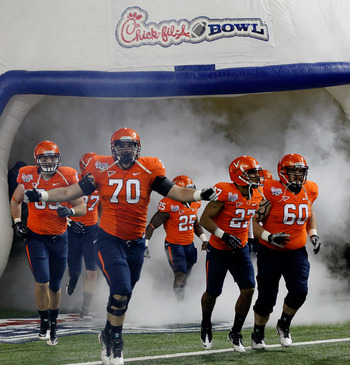 ATLANTA, GA - DECEMBER 31:  The Virginia Cavaliers enter the field to face the Auburn Tigers during the 2011 Chick Fil-A Bowl at Georgia Dome on December 31, 2011 in Atlanta, Georgia.  (Photo by Kevin C. Cox/Getty Images)