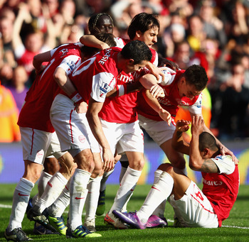 Walcott is mobbed by his teammates