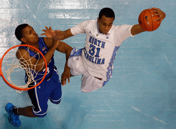 CHAPEL HILL, NC - MARCH 05:  Tyler Thornton #3 of the Duke Blue Devils goes after a rebound with John Henson #31 of the North Carolina Tar Heels during their game at the Dean E. Smith Center on March 5, 2011 in Chapel Hill, North Carolina.  (Photo by Stre