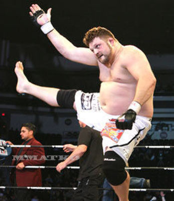 The ever agile Roy Nelson performs a toe-touch...almost.