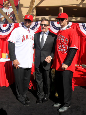 ANAHEIM, CA - DECEMBER 10:  Angels owner Arturo Moreno stands between Albert Pujols #5 and C.J. Wilson #33 at a public press conference introducing them as newly signed Los Angeles Angels of Anaheim  players at Angel Stadium on December 10, 2011 in Anahei