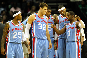 CHARLOTTE, NC - FEBRUARY 11:  Teammates Blake Griffin #32 of the Los Angeles Clippers Ryan Gomes #15 and Kenyon Martin #2 and Mo Williams #25 listen to Chris Paul #3 during a timeout against the Charlotte Bobcats at Time Warner Cable Arena on February 11,