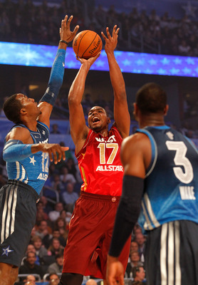 ORLANDO, FL - FEBRUARY 26:  Andrew Bynum #17 of the Los Angeles Lakers and the Western Conference attempts a shot against Dwight Howard #12 of the Orlando Magic and the Eastern Conference during the 2012 NBA All-Star Game at the Amway Center on February 2