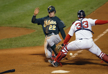 Varitek prevented Eric Byrnes from touching the plate, keying the Sox rally from a 2-0 deficit to win the series