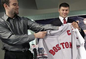 "Varitek is presented with a jersey bearing the captain's ""C"""