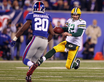 Prince Amukamara eyes Aaron Rodgers.