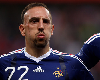 LENS, FRANCE - MAY 26:  Franck Ribery (l) and Nicolas Anelka (r) of France line up prior to the France v Costa Rica International Friendly match at Stade Felix Bollaert on May 26, 2010 in Lens, France.  (Photo by Michael Steele/Getty Images)