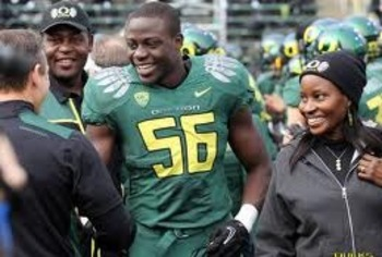 Josh Kaddu with his parents on Senior Day