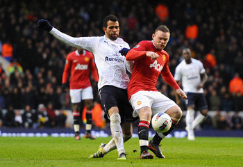 LONDON, ENGLAND - MARCH 04:  Sandro of Tottenham Hotspur closes down Wayne Rooney of Manchester United during the Barclays Premier League match between Tottenham Hotspur and Manchester United at White Hart Lane on March 4, 2012 in London, England.  (Photo