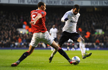 LONDON, ENGLAND - MARCH 04:  Rio Ferdinand of Manchester United taclkes Sandro of Tottenham Hotspur during the Barclays Premier League match between Tottenham Hotspur and Manchester United at White Hart Lane on March 4, 2012 in London, England.  (Photo by