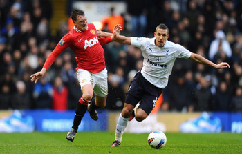 LONDON, ENGLAND - MARCH 04:  Phil Jones of Manchester United and Jake Livermore of Tottenham Hotspur battle for the ball during the Barclays Premier League match between Tottenham Hotspur and Manchester United at White Hart Lane on March 4, 2012 in London