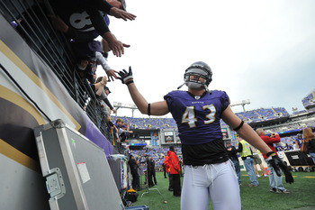 BALTIMORE - NOVEMBER 20:  Haruki Nakamura #43 of the Baltimore Ravens greets fans before the game against the Cincinnati Bengals at M&T Bank Stadium on November 20, 2011 in Baltimore, Maryland. The Ravens defeated the Bengals 31-24. (Photo by Larry French