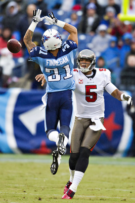 NASHVILLE, TN - NOVEMBER 27:   Quarterback Josh Freeman #5 of the Tampa Bay Buccaneers throws a pass around Cortland Finnegan #31 of the Tennessee Titans at LP Field on November 27, 2011 in Nashville, Tennessee.  (Photo by Wesley Hitt/Getty Images)