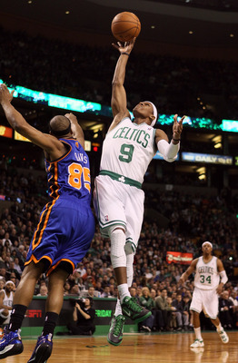 BOSTON, MA - MARCH 04:  Rajon Rondo #9 of the Boston Celtics takes a shot as Baron Davis #85 of the New York Knicks defends on March 4, 2012 at TD Garden in Boston, Massachusetts. NOTE TO USER: User expressly acknowledges and agrees that, by downloading a