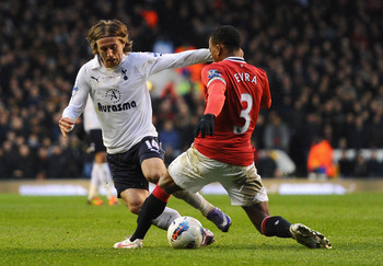 Tottenham Hotspur's Luka Modric (L) vies for the ball with Manchester United captain Patrice Evra (R).