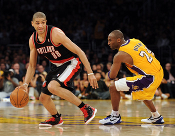 Small forward Batum driving past Kobe