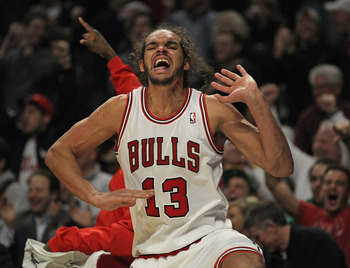CHICAGO, IL - MARCH 05: Joakim Noah #13 of the Chicago Bulls celebrates after teammate Brian Scalabrine hit a basket with less than a minute to go in a game against the Indiana Pacers at the United Center on March 5, 2012 in Chicago, Illinois. The Bulls d