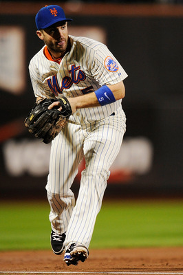 NEW YORK, NY - SEPTEMBER 27:  David Wright #5 of the New York Mets fields a ball against the Cincinnati Reds in the third inning of a game at Citi Field on September 27, 2011 in the Flushing neighborhood of the Queens borough of New York City.  (Photo by