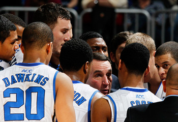 ATLANTA, GA - MARCH 10:  Head coach Mike Krzyzewski of the Duke Blue Devils talks to his team in the second half against the Florida State Seminoles during the semifinals of the 2012 ACC Men's Basketball Conferene Tournament at Philips Arena on March 10,