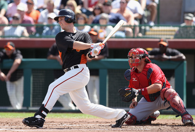 SCOTTSDALE, AZ - MARCH 27:  Buster Posey #28 of the San Francisco Giants bats against the Los Angeles Angels of Anaheim during the spring training game at Scottsdale Stadium on March 27, 2012 in Scottsdale, Arizona.  (Photo by Christian Petersen/Getty Ima