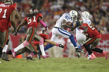 Wayne charging through a group of Tampa Bay defenders.