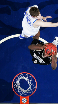 Vandy's Lance Goulbourne prepares to slam it home during the Commodores' upset of Kentucky in the SEC championship game.