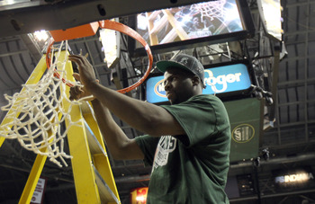 INDIANAPOLIS, IN - MARCH 11:  Draymond Green #23 of the Michigan State Spartans celebrates after he cut down a piece of the net following their 68-64 win against the Ohio State Buckeyes during the Final Game of the 2012 Big Ten Men's Conference Basketball