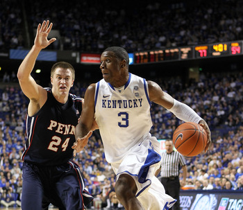 Kentucky, beating Penn 77-54, drives right by the Quakers to the hoop.