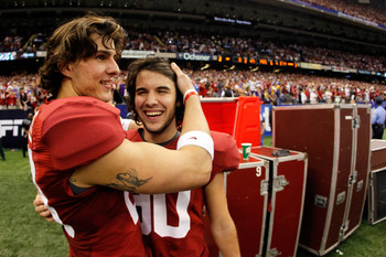 Cody Mandell celebrating with kicker Jeremy Shelley.