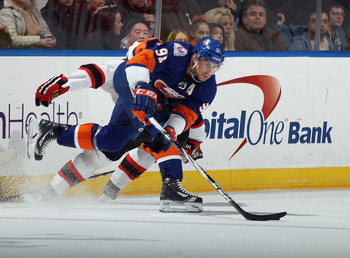 UNIONDALE, NY - MARCH 10:  John Tavares #91 of the New York Islanders skates against the New Jersey Devils at the Nassau Veterans Memorial Coliseum on March 10, 2012 in Uniondale, New York. The Devils defeated the Islanders 2-1.  (Photo by Bruce Bennett/G