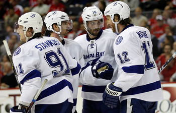 WASHINGTON, DC - MARCH 08: Teddy Purcell #16 of the Tampa Bay Lightning (C) celebrates the Lightning's second period goal against the Washington Capitals with teammates Steven Stamkos #91, Martin St. Louis #26, and Ryan Malone #12 at the Verizon Center on