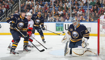 BUFFALO, NY - MARCH 07:  Ryan Miller #30 of the Buffalo Sabres makes a save as Christian Ehrhoff #10 and Mike Weber #6 of the Buffalo Sabres both look on along with Jiri Tlusty #19 of the Carolina Hurricanes during their NHL game at First Niagara Center o