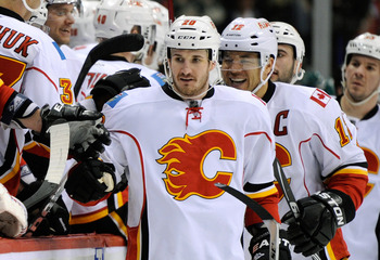 ST PAUL, MN - MARCH 11: Curtis Glencross #20 and Jarome Iginla #12 of the Calgary Flames celebrate a goal by Glencross during the third period against the Minnesota Wild on March 11, 2012 at Xcel Energy Center in St Paul, Minnesota. The Flames defeated th