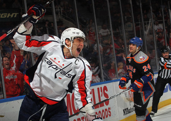UNIONDALE, NY - MARCH 13: Alex Ovechkin #8 of the Washington Capitals ties the score at 4-4 at 10:15 of the third period against the New York Islanders at the Nassau Veterans Memorial Coliseum on March 13, 2012 in Uniondale, New York. The Capitals defeate