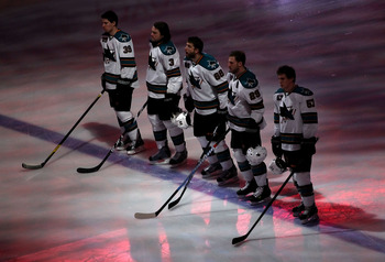 GLENDALE, AZ - MARCH 10:  (L-R) Logan Couture #39, Douglas Murray #3, Brent Burns #88, Ryane Clowe #29 and Tommy Wingels #57 of the San Jose Sharks stand attended for the Natinoal Anthem before the NHL game against the Phoenix Coyotes at Jobing.com Arena
