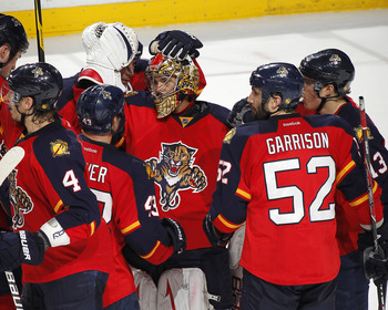 SUNRISE, FL - MARCH 13: Goaltender Jose Theodore #60 of the Florida Panthers is congratulated by teammates after defeating the Toronto Maple Leafs on March 13, 2012 at the BankAtlantic Center in Sunrise, Florida. The Panthers defeated the Maple Leafs 5-2.