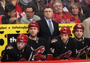 GLENDALE, AZ - MARCH 01:  Head coach Dave Tippett of the Phoenix Coyotes watches from the bench during the NHL game against the Calgary Flames at Jobing.com Arena on March 1, 2012 in Glendale, Arizona.  The Flames defeated the Coyotes 4-2.  (Photo by Chri