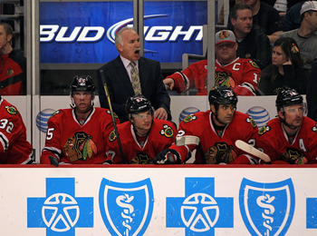 CHICAGO, IL - FEBRUARY 23: Head coach Joel Quenneville of the Chicago Blackhawks gives instructions to his team during a game against the Dallas Stars at the United Center on February 23, 2012 in Chicago, Illinois. The Stars defeated the Blackhawks 3-1. (