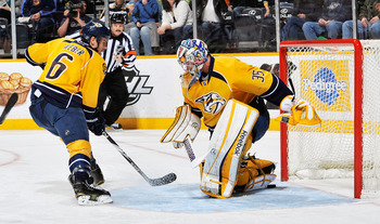 NASHVILLE, TN - MARCH 06:  Shea Weber #6 of the Nashville Predators watches a puck slide into the net under goalie Pekka Rinne #35 against the Los Angeles Kings at the Bridgestone Arena on March 6, 2012 in Nashville, Tennessee.  (Photo by Frederick Breedo