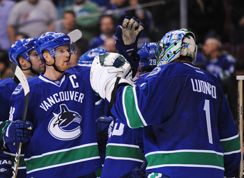 VANCOUVER, CANADA - MARCH 1: Henrik Sedin #33 congratulates goaltender Roberto Luongo #1 of the Vancouver Canucks on his shutout against the St. Louis Blues in NHL action on March, 1, 2012 at Rogers Arena in Vancouver, British Columbia, Canada. (Photo by
