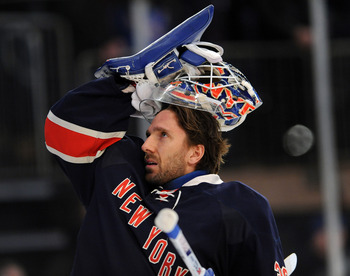 NEW YORK, NY - MARCH 04:  Henrik Lundqvist #30 of the New York Rangers puts his helmet on prior to the game against the Boston Bruins at Madison Square Garden on March 4, 2012 in New York City. (Photo by Christopher Pasatieri/Getty Images)