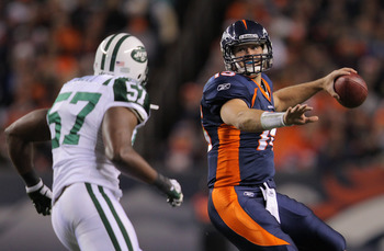 DENVER, CO - NOVEMBER 17:  Tim Tebow #15 of the Denver Broncos throws a pass as he is pressured by Bart Scott #57 of the New York Jets in the first quarter at Invesco Field at Mile High on November 17, 2011 in Denver, Colorado.  (Photo by Doug Pensinger/G