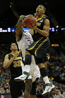 KANSAS CITY, MO - MARCH 10:  Phil (Flip) Pressey #1 of the Missouri Tigers goes up for a shot against Ray Turner #35 of the Texas A&M Aggies during their quarterfinal game in the 2011 Phillips 66 Big 12 Men's Basketball Tournament at Sprint Center on Marc