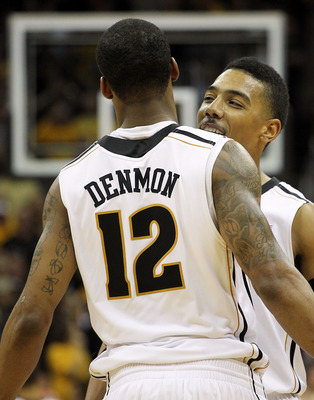 KANSAS CITY, MO - MARCH 10:  Phil Pressey #1 and Marcus Denmon #12 of the Missouri Tigers celebrate as the Tigers defeated the Baylor Bears 90 to 75 to win the championship game of the 2012 Big 12 Men's Basketball Tournament at Sprint Center on March 10,