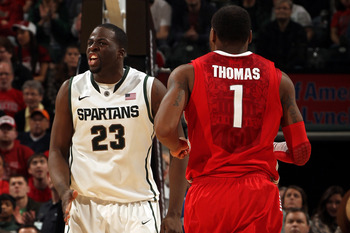 INDIANAPOLIS, IN - MARCH 11:  Draymond Green #23 of the Michigan State Spartans reacts against Deshaun Thomas #1 of the Ohio State Buckeyes during the Final Game of the 2012 Big Ten Men's Conference Basketball Tournament at Bankers Life Fieldhouse on Marc